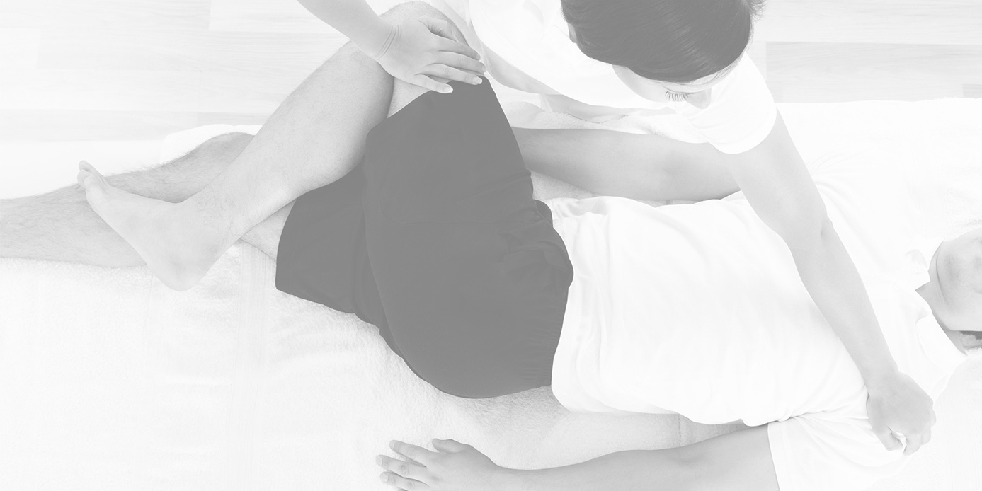 doctor assisting patient in piriformis stretch for outer hip and thigh muscles