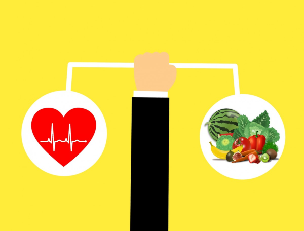 balanced heart health with vegetables, scale with steady heart rate symbol on left, mixed vegetables on right
