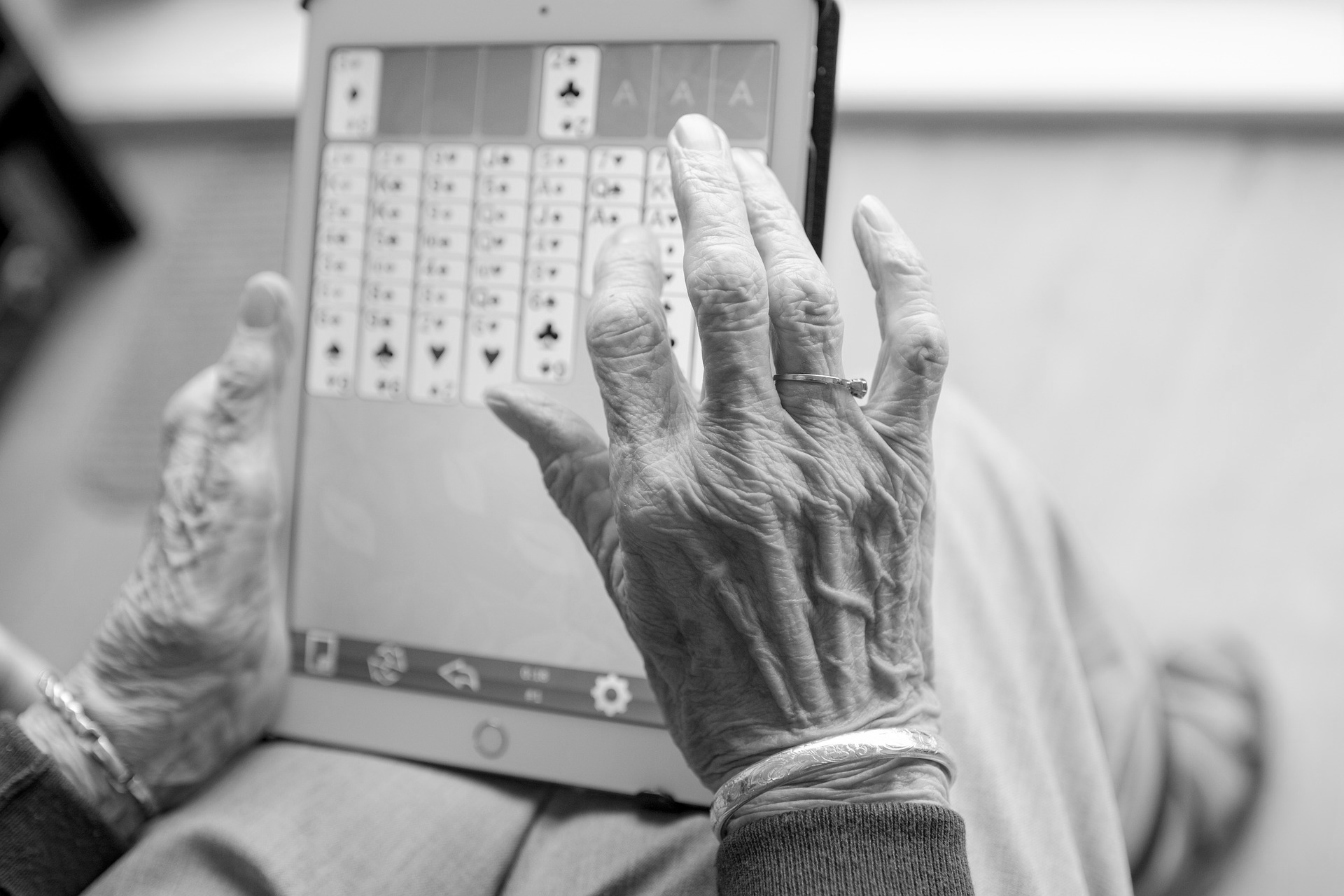 senior playing Freecell on a tablet