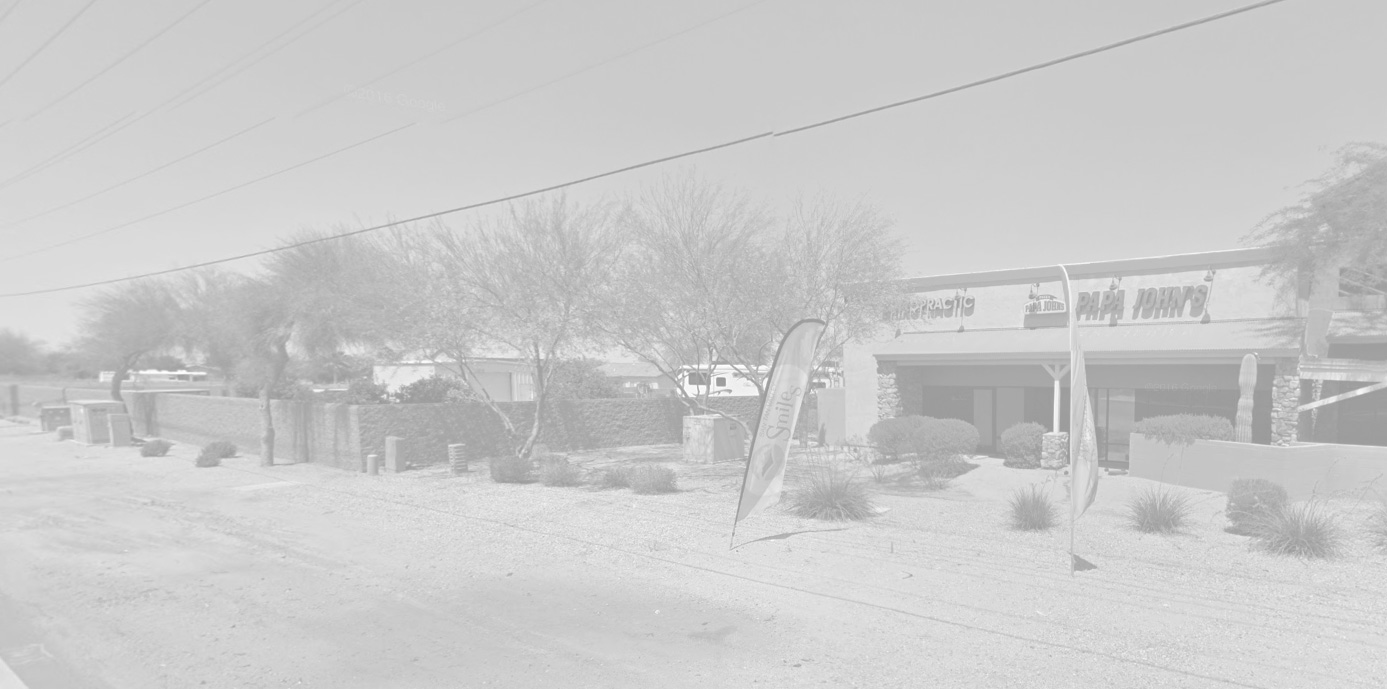 view of chiropractor in San Tan and surrounding stores, street, and hedges